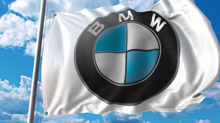 Waving flag with Bmw logo against sky and clouds. Editorial 3D rendering Editorial