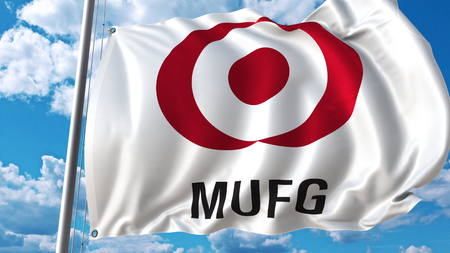 Waving flag with Bank Of Tokyo Mitsubishi logo against sky and clouds. Editorial 3D rendering
