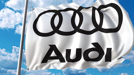 Waving flag with Audi logo against sky and clouds. Editorial 3D rendering Editorial