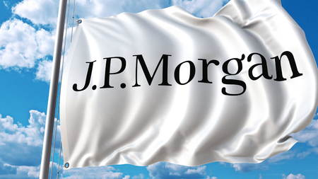 Waving flag with J.P. Morgan logo against sky and clouds. Editorial 3D rendering Publikacyjne