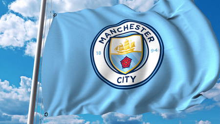 Waving flag with Manchester City football team logo. Editorial 3D rendering