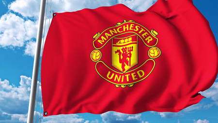 Waving flag with Manchester United football team logo. Editorial 3D rendering Stock Photo - 81254259