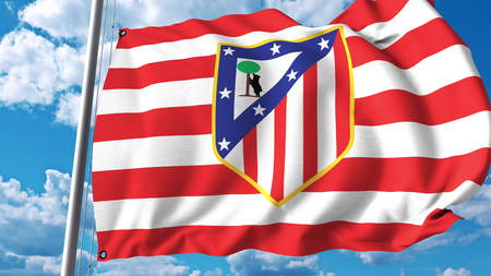 Waving flag with Atletico Madrid football team logo. Editorial 3D rendering Editorial
