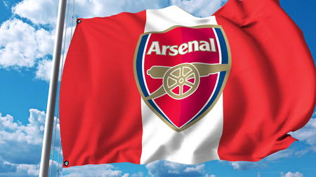 Waving flag with Arsenal football team logo. Editorial 3D rendering
