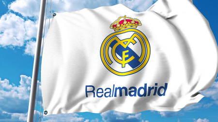 레알 마드리드 축구 팀 로고와 깃발을 흔들며. Editorial 3D rendering