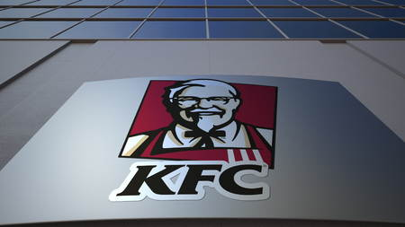 Outdoor signage board with Kentucky Fried Chicken KFC logo. Modern office building. Editorial 3D rendering