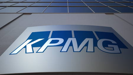 lawer: Outdoor signage board with KPMG logo. Modern office building. Editorial 3D rendering