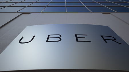 Outdoor signage board with Uber Technologies Inc. logo. Modern office building. Editorial 3D rendering Redactioneel