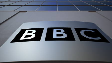Outdoor signage board with British Broadcasting Corporation BBC logo. Modern office building. Editorial 3D rendering