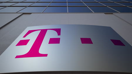 Outdoor signage board with T-Mobile logo. Modern office building. Editorial 3D rendering Publikacyjne