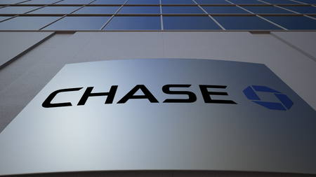 Outdoor signage board with JPMorgan Chase Bank logo. Modern office building. Editorial 3D rendering