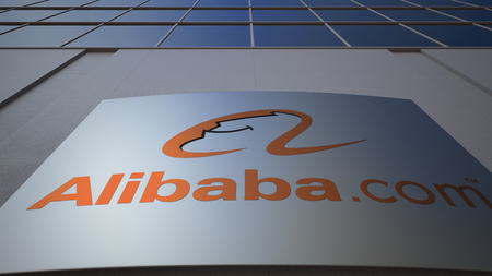 Outdoor signage board with Alibaba.com logo. Modern office building. Editorial 3D rendering