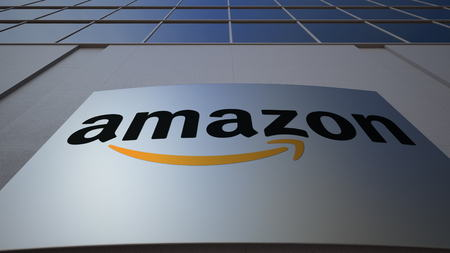 Outdoor signage board with Amazon.com logo. Modern office building. Editorial 3D rendering Éditoriale