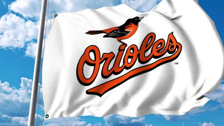 Waving flag with Baltimore Orioles professional team logo. Editorial 3D rendering