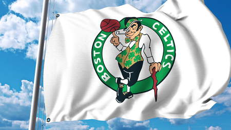 Waving flag with Boston Celtics professional team logo. Editorial 3D rendering Editorial