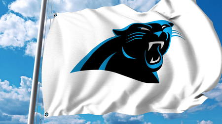 Waving flag with Carolina Panthers professional team logo. Editorial 3D rendering