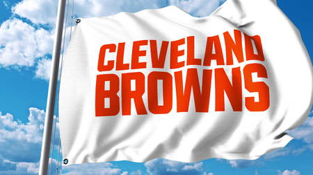 Waving flag with Cleveland Browns professional team logo. Editorial 3D rendering