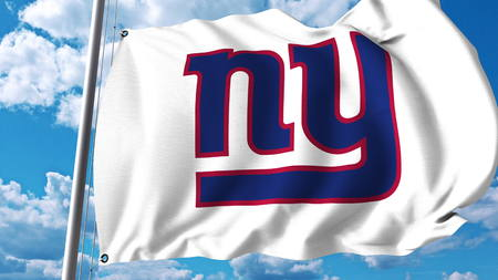 Waving flag with New York Giants professional team logo. Editorial 3D rendering Publikacyjne
