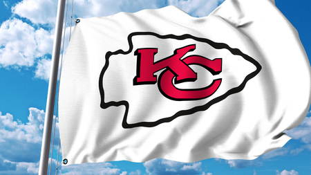 Waving flag with Kansas City Chiefs professional team logo. Editorial 3D rendering Editorial