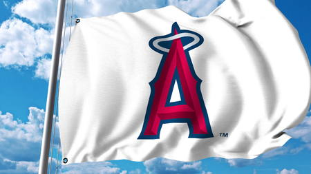 Waving flag with Los Angeles Angels Of Anaheim professional team logo. Editorial 3D rendering Editorial