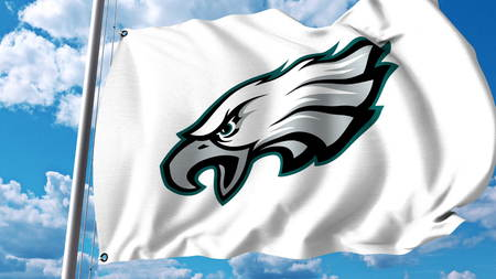 Waving flag with Philadelphia Eagles professional team logo. Editorial 3D rendering