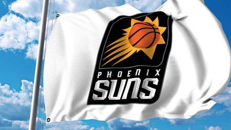 Waving flag with Phoenix Suns professional team logo. Editorial 3D rendering