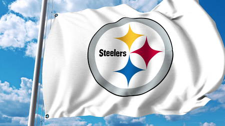 Waving flag with Pittsburgh Steelers professional team logo. Editorial 3D rendering Editorial