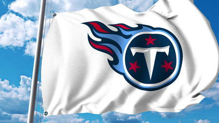 titans: Waving flag with Tennessee Titans professional team logo. Editorial 3D rendering Editorial