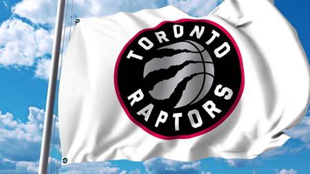 Waving flag with Toronto Raptors professional team logo. Editorial 3D rendering Editorial