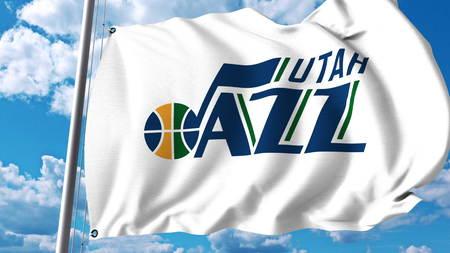 Waving flag with Utah Jazz professional team logo. Editorial 3D rendering