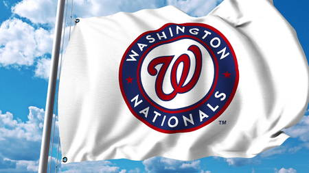 Waving flag with Washington Nationals professional team logo. Editorial 3D rendering