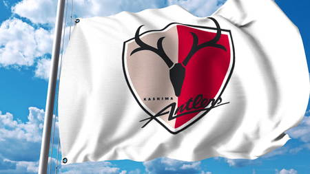 Waving flag with Kashima Antlers football club logo. Editorial 3D rendering Editöryel