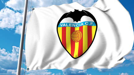 Waving flag with Valencia CF football club logo. Editorial 3D rendering
