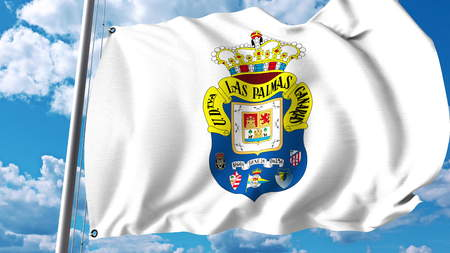 Waving flag with UD Las Palmas football club logo. Editorial 3D rendering