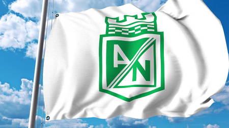 Waving flag with Atletico Nacional football club logo. Editorial 3D rendering Editorial