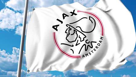 Waving flag with AFC Ajax football club logo. Editorial 3D rendering