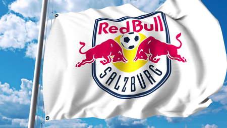 agitant le drapeau avec le football rouge joueur de football du joueur de football . rendu 3d éditorial