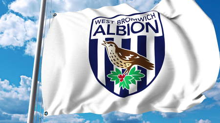 Waving flag with West Bromwich Albion FC football club logo. Editorial 3D rendering Editorial