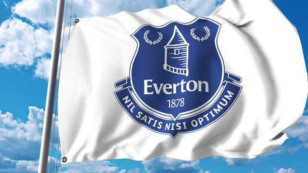 Waving flag with Everton FC football club logo. Editorial 3D rendering Редакционное