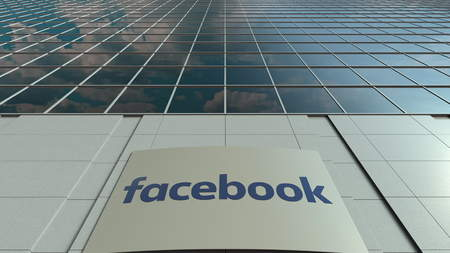 Signage board with Facebook logo. Modern office building facade. Editorial 3D rendering