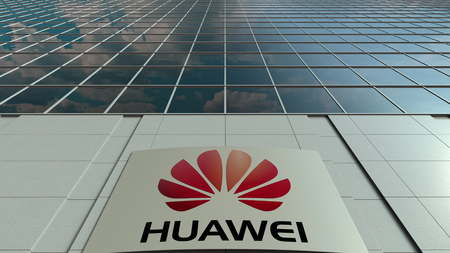 Signage board with Huawei logo. Modern office building facade. Editorial 3D rendering 에디토리얼