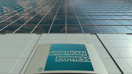 Signage board with American Express logo. Modern office building facade. Editorial 3D rendering
