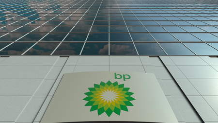 Signage board with BP logo. Modern office building facade. Editorial 3D rendering