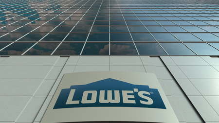 Signage board with Lowes logo. Modern office building facade. Editorial 3D rendering