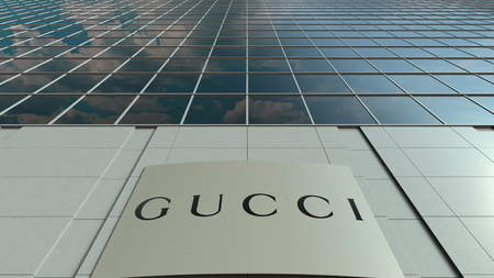 Signage board with Gucci logo. Modern office building facade. Editorial 3D rendering