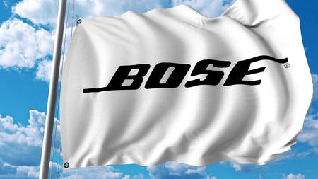 Waving flag with Bose Corporation logo. Editoial 3D rendering