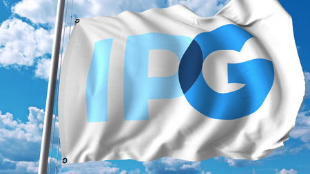 Waving flag with Interpublic Group Of Companies logo. Editoial 3D rendering Editorial