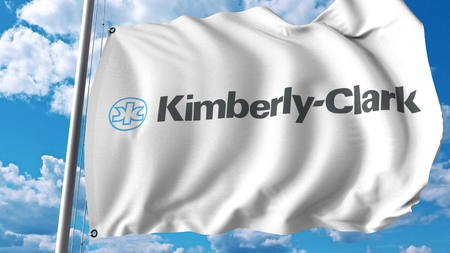 Waving flag with Kimberly Clark logo. Editoial 3D rendering Editorial