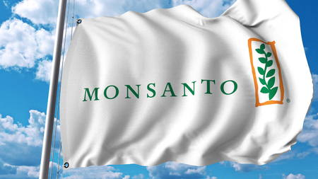 Waving flag with Monsanto logo. Editoial 3D rendering Editorial