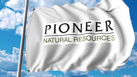 Waving flag with Pioneer Natural Resources logo. Editoial 3D rendering
